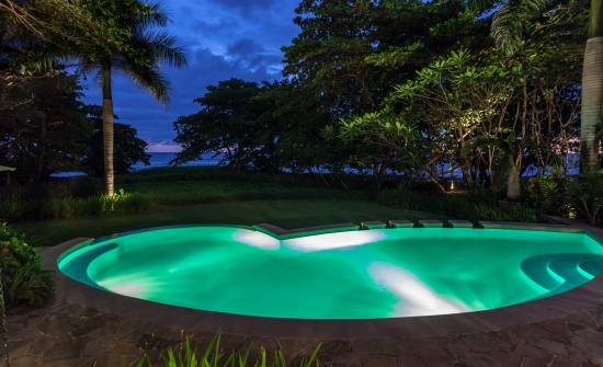 Latitude 10 Resort pool at night