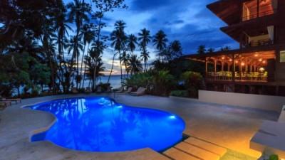 Playa Cativo Lodge swimming pool at dawn