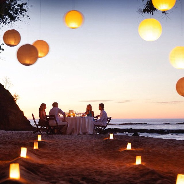 A romantic #sunset beach dinner captured perfectly by The Four Seasons #costarica #vacations @fscostarica